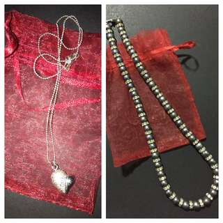 One silver heart-shaped pendant with a chain & One bead necklace