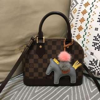Leather horse with mini Pom Pom ball
