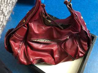Red purse with  Leopard print inside