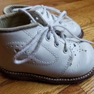 Genuine leather baby baptism white shoes.  Leather sole. Leather outer. Leather inner. Italian made craftmanship. Paid $99  Pick up Beaches or Yorkville. Ad will be removed once sold.