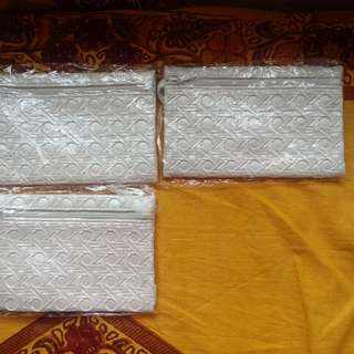 White pouches at $5 each