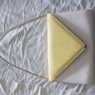 White and yellow with gold trim clutch