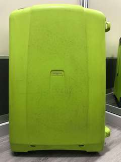Samsonite luggage in lime green
