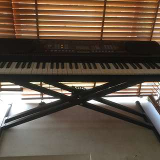 Electronic keyboard with x stand