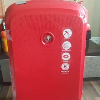 Delsey red luggage