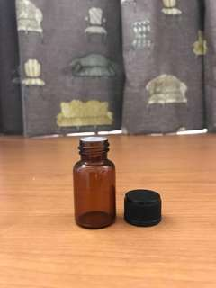 Empty Essential Oils Amber Glass Bottle with plastic stopper and black cap. 10ml. Add $1 for normal mail.