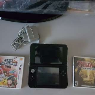 Nintendo 3DS XL (Black color) + charging cable + 2 games