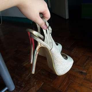 Gold high heels size 7