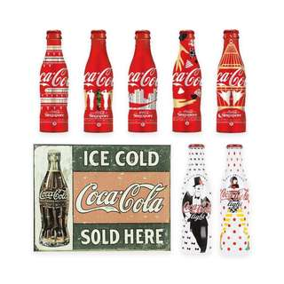 Coca Cola collectible bottles and metal sign