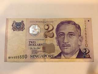 $2 - Paper note with almost solid number