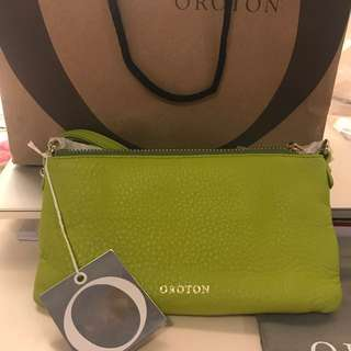 Oroton Bueno- clutch bag in lime sherbet