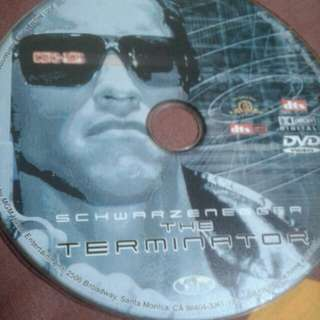 DVD  ENGLISH MOVIE  The Terminator  Disguised as a human, a cyborg assassin known as a Terminator (Arnold Schwarzenegger) travels from 2029 to 1984 to kill Sarah Connor (Linda Hamilton). Sent to protect Sarah