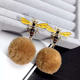 Bee studded pompom earrings