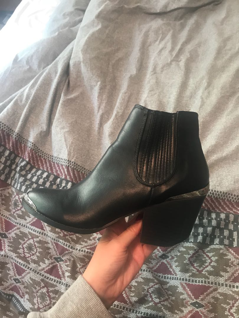 Black boots with metal detail