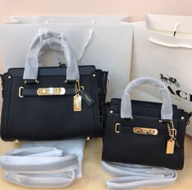 312235377 Coach Swagger 27 Coach Swagger 21 Bag (black), Women's Fashion, Bags &  Wallets on Carousell