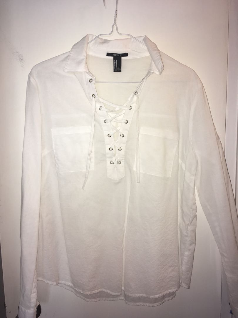 Front-laced white blouse