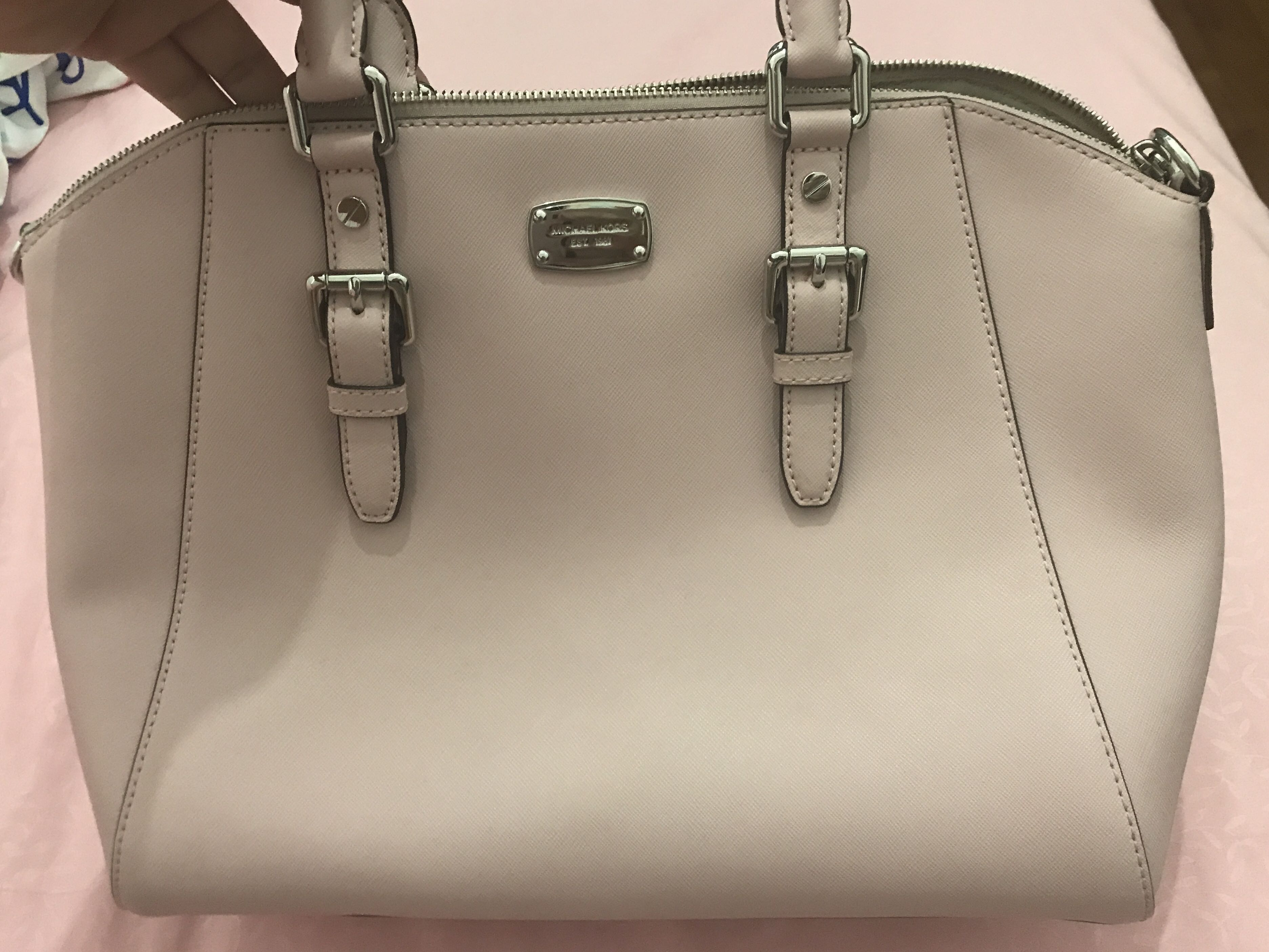 29129cbb8410 Michael Kors Baby Pink handbag with sling
