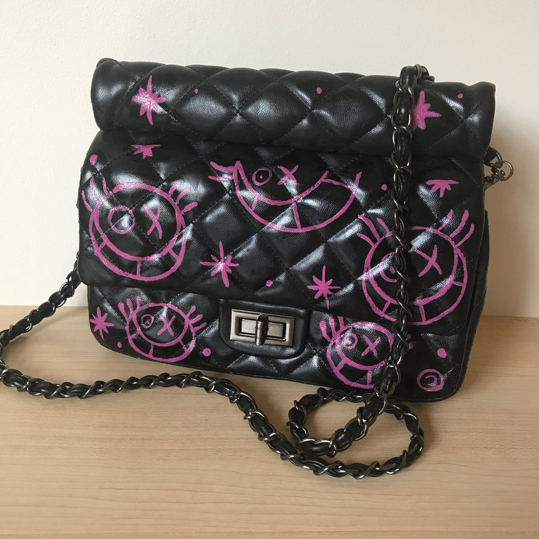 Scrawled Quilted clutch with chain