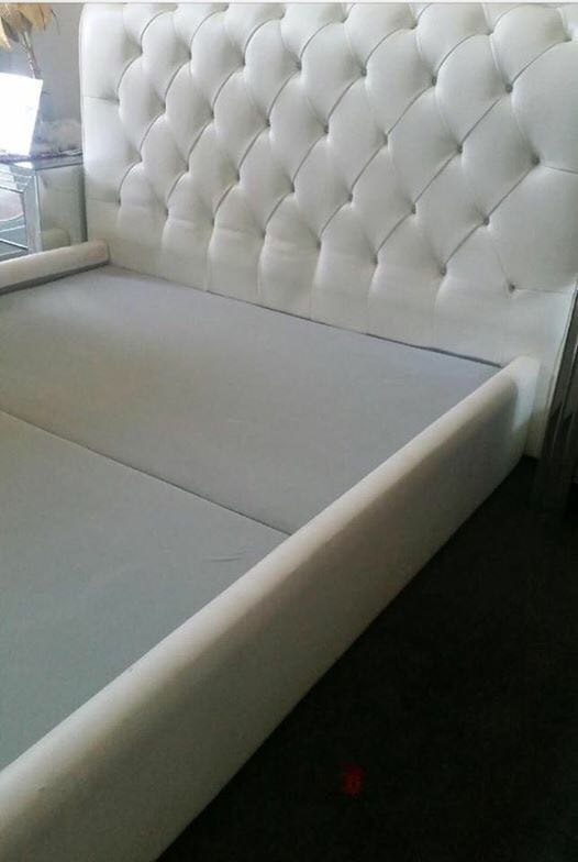 White leather diamond pinned queen bed