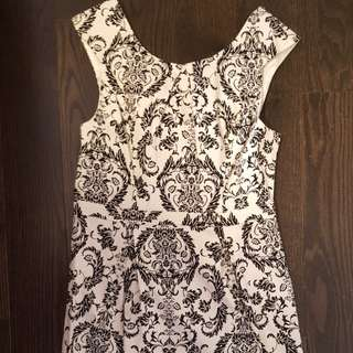 Short, fitted black and white dress