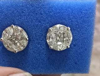 6 carat face first generation illusion earrings set in 18k white gold.