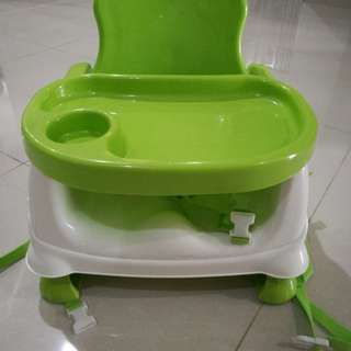 Booster high chair with detachable meal plate