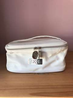White SKII cosmetic bag with compartments