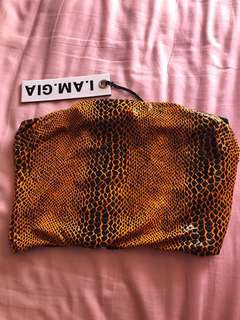 I am gia orange snakeskin crop