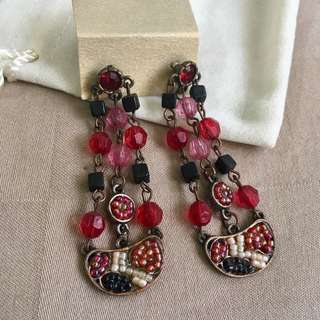 Brand new dangling red vintage style chinos earrings