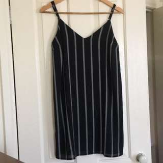 Black mini slip-ons with stripes