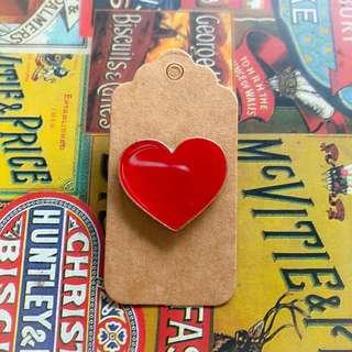 Shape of a heart enamel pin