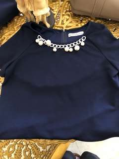 Blue top with pearl