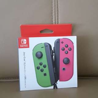 Nintendo Switch Joy con neon green and pink