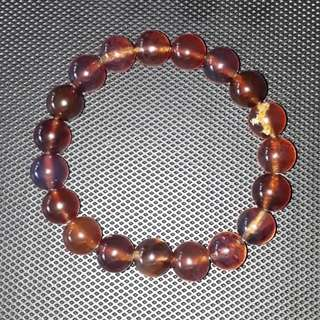 Very rare and precious Blue Amber Bracelet. Size 10mm beads. Unfortunately the camera unable to capture its blue, put it under sport light it will show blue clearly.