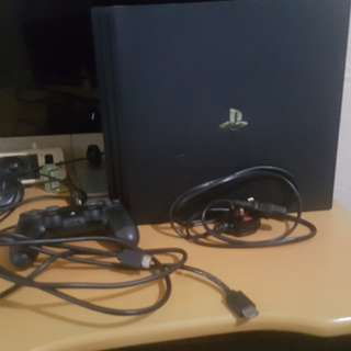 Used but not abused Ps4 Pro with Games