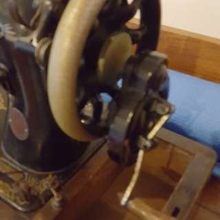 Hand crank sewing machine in original box base