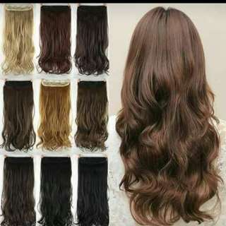 Human hair extensions & synthetic hair .