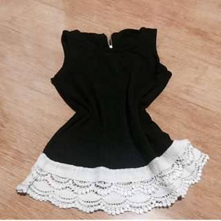 Black top with lace trims.