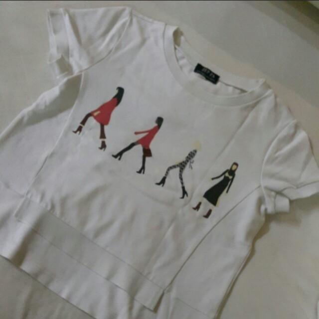 Baju putih motif orang bahan tebal
