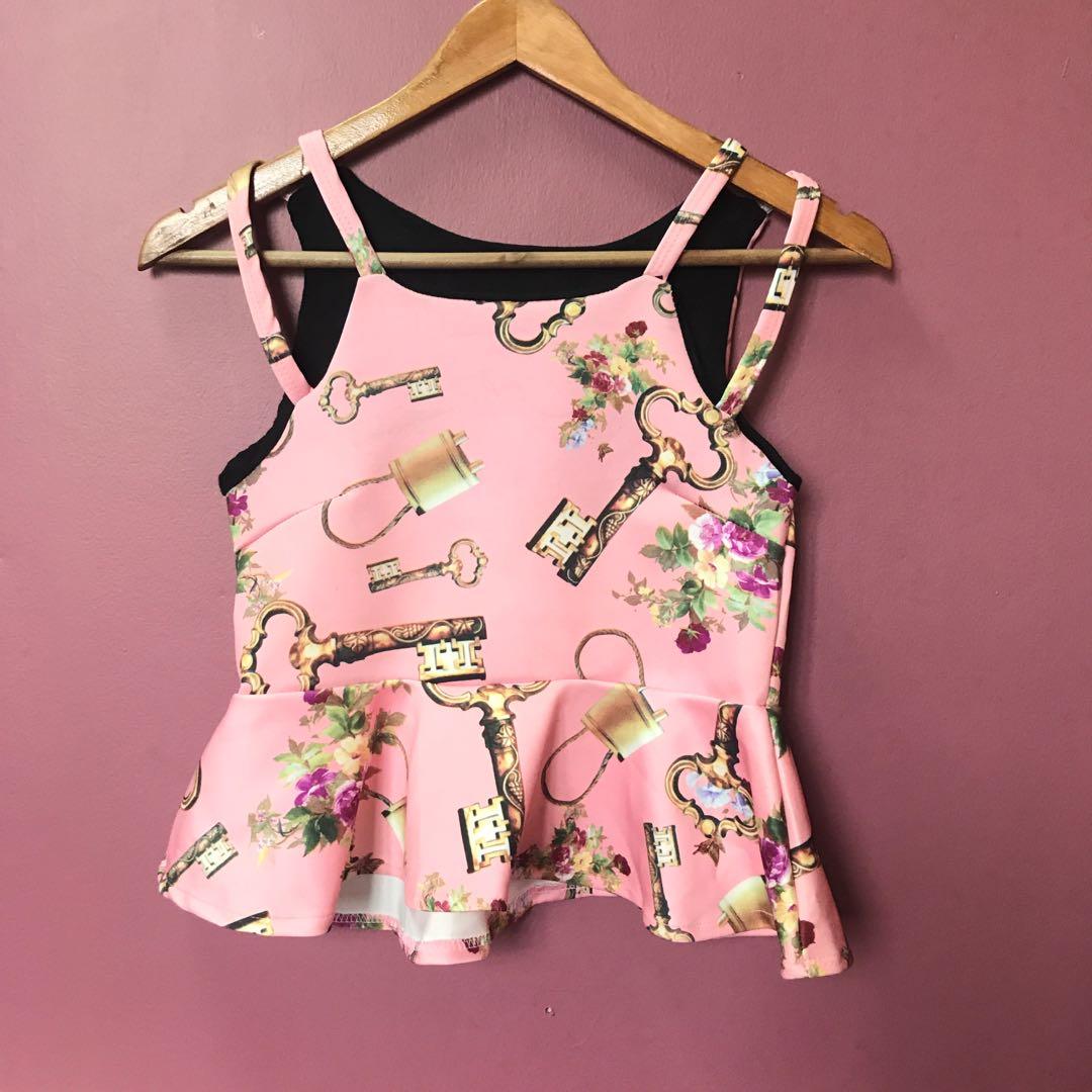 Pink Printed Sleeveless Peplum Top