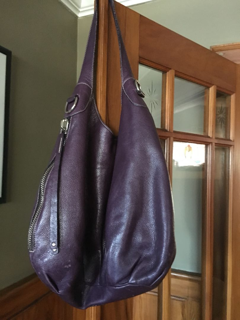 Roots satchel deep purple. Perfect condition. Leather