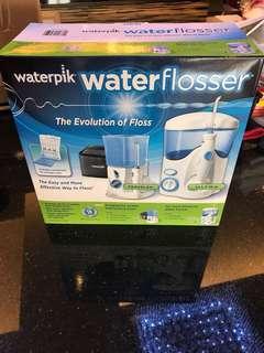 Dental - Waterpik water flosser + free voltage converter