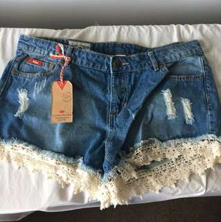 Ripped shorts with lace detail