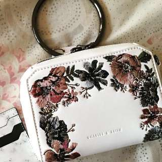 Brand new & authentic - charles & Keith white floral clutch