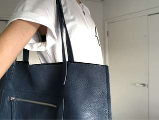 Navy tote bag with silver zip detail