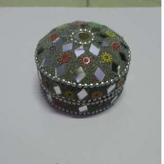 Silver colored handcrafted small container
