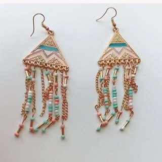 Pyramid dangling earrings in pink blue