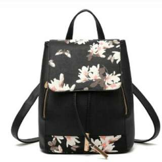 black floral  leather back pack bag