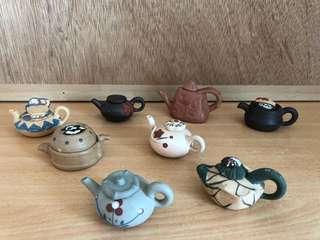 Antique mini teapots
