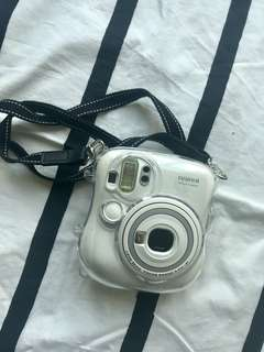 White Instax mini 25 with protection